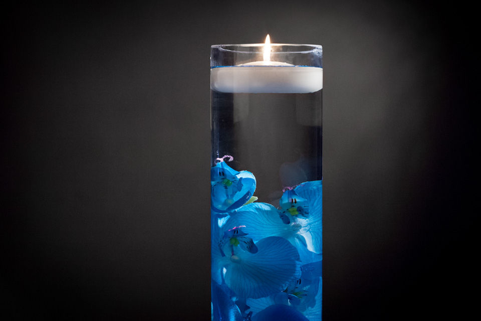 Blue Floral Centerpiece With Led Lights And Floating Candles