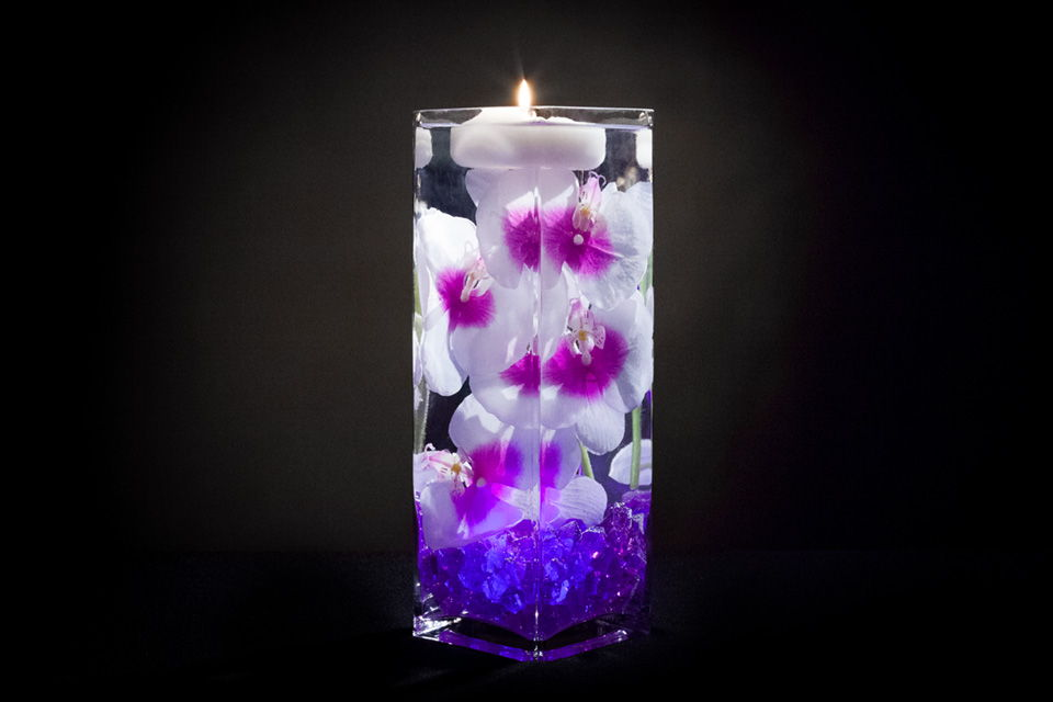Floral Centerpiece Lights : Violet floral centerpiece with led lights and floating candles