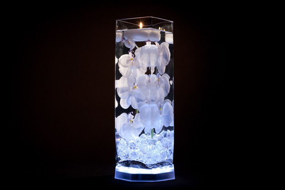 White floral centerpiece with led lights and floating candles