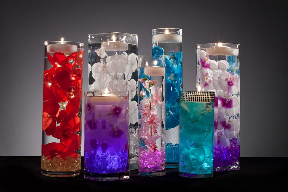 Floral centerpieces with led lights and floating candles for How to make flowers float in vases