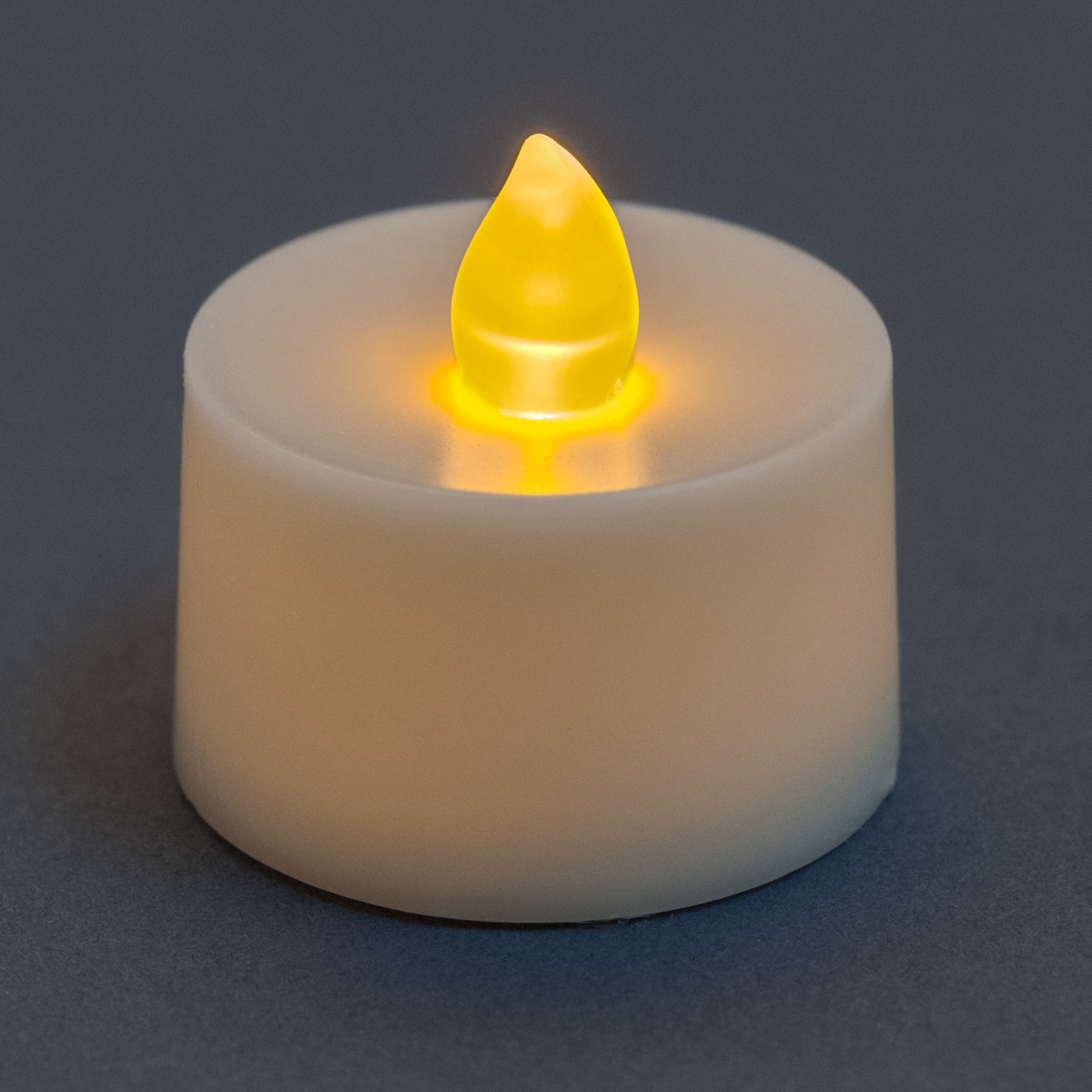 flickering battery operated tea light candle amber. Black Bedroom Furniture Sets. Home Design Ideas